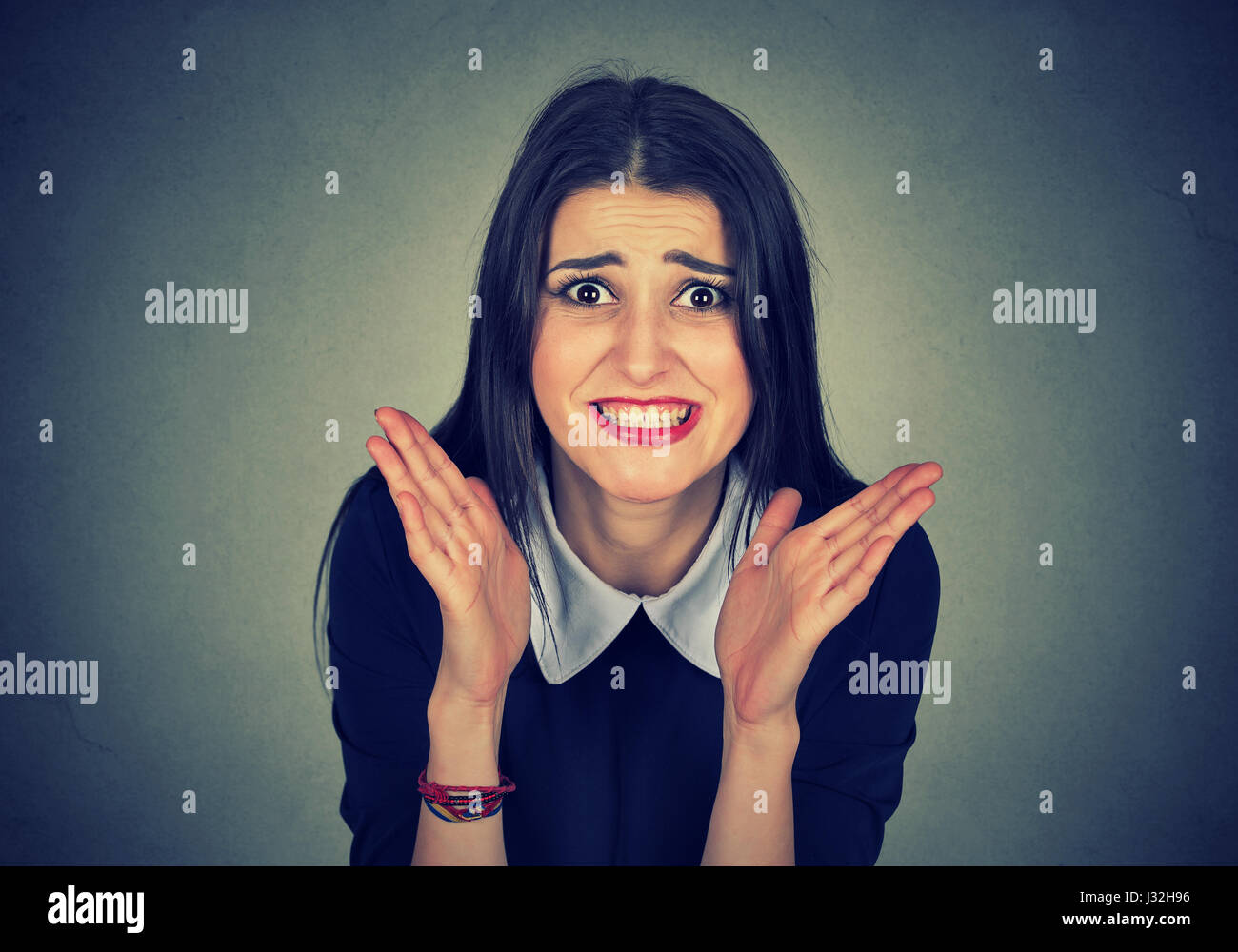 beautiful angry woman isolated on gray background - Stock Image