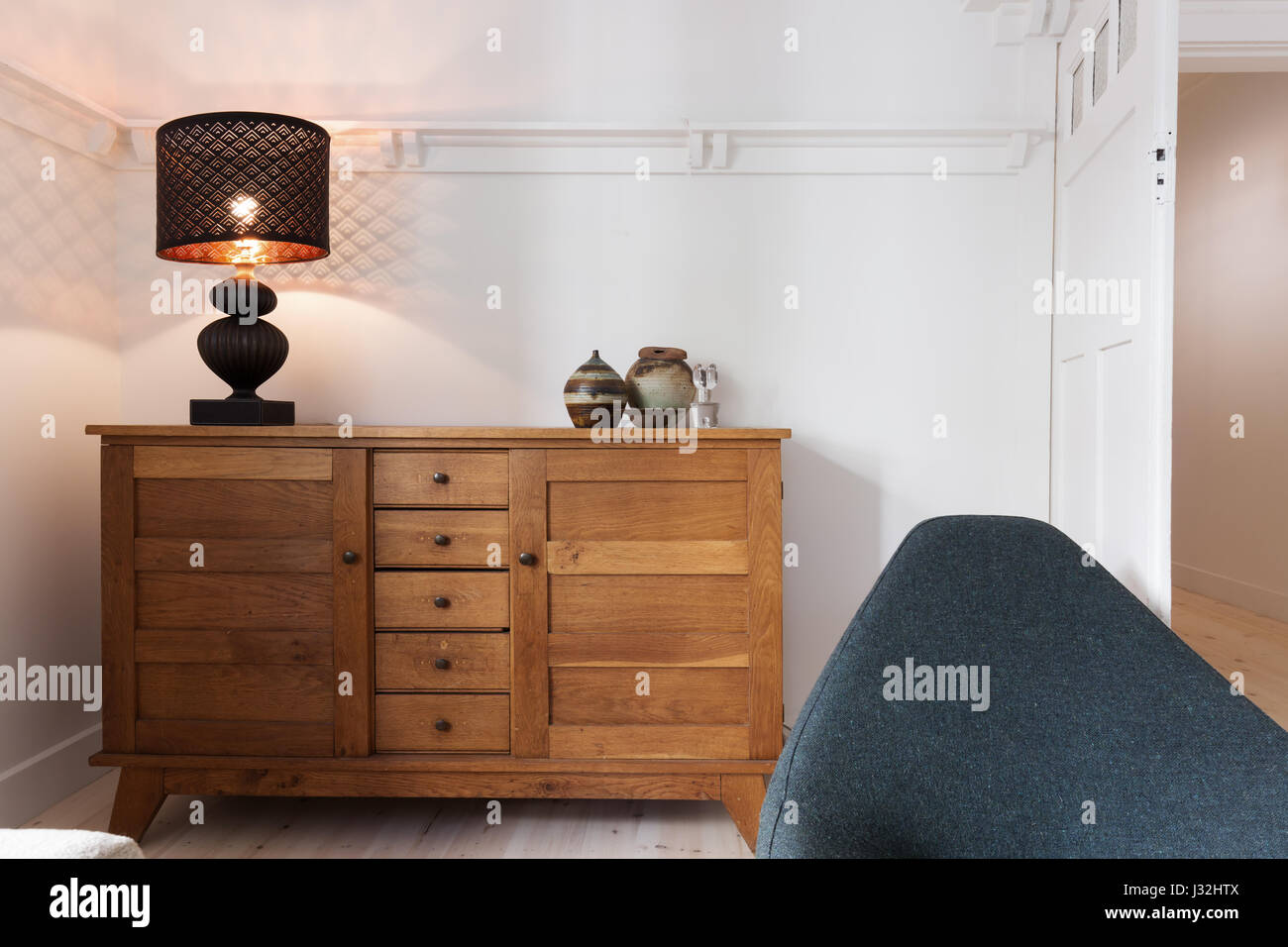 Illuminated Lamp On Sideboard Buffet In Luxury Living Room Stock