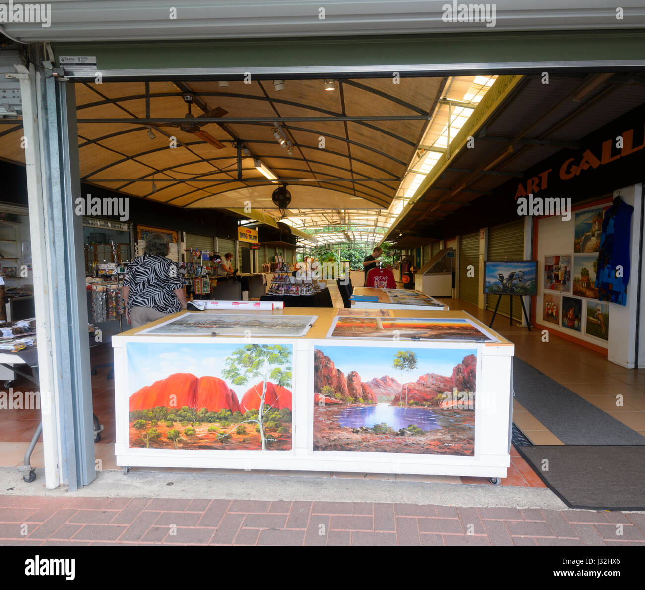 Shop selling paintings as souvenirs for tourists, Kuranda Village, Far North Queensland, FNQ, QLD, Australia - Stock Image
