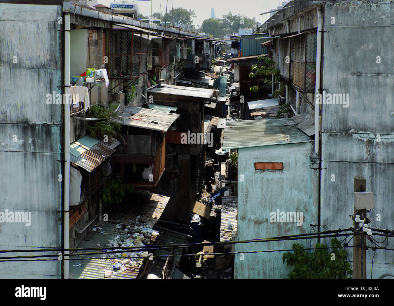 Awful scene behind of old apartment building, extension living space like cote make danger, unsafe situation, rubbish - Stock Image