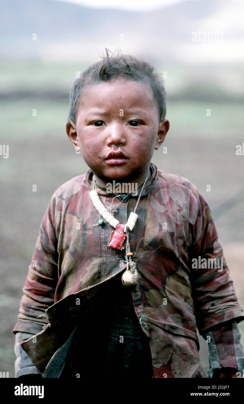 Young Tibetan boy from the Grasslands of Tibet, China - Stock Image