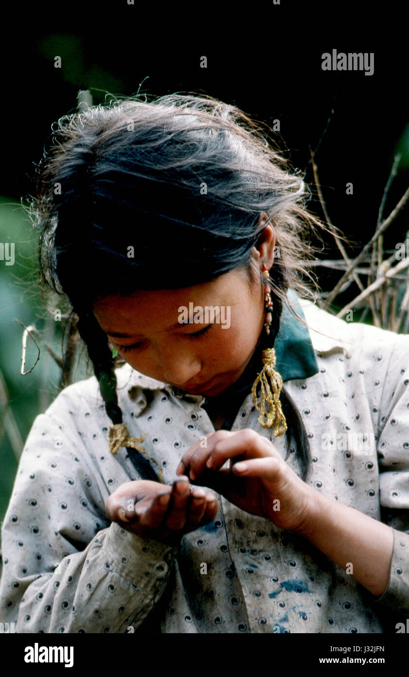 Young girl from the Grasslands of Tibet in China. - Stock Image