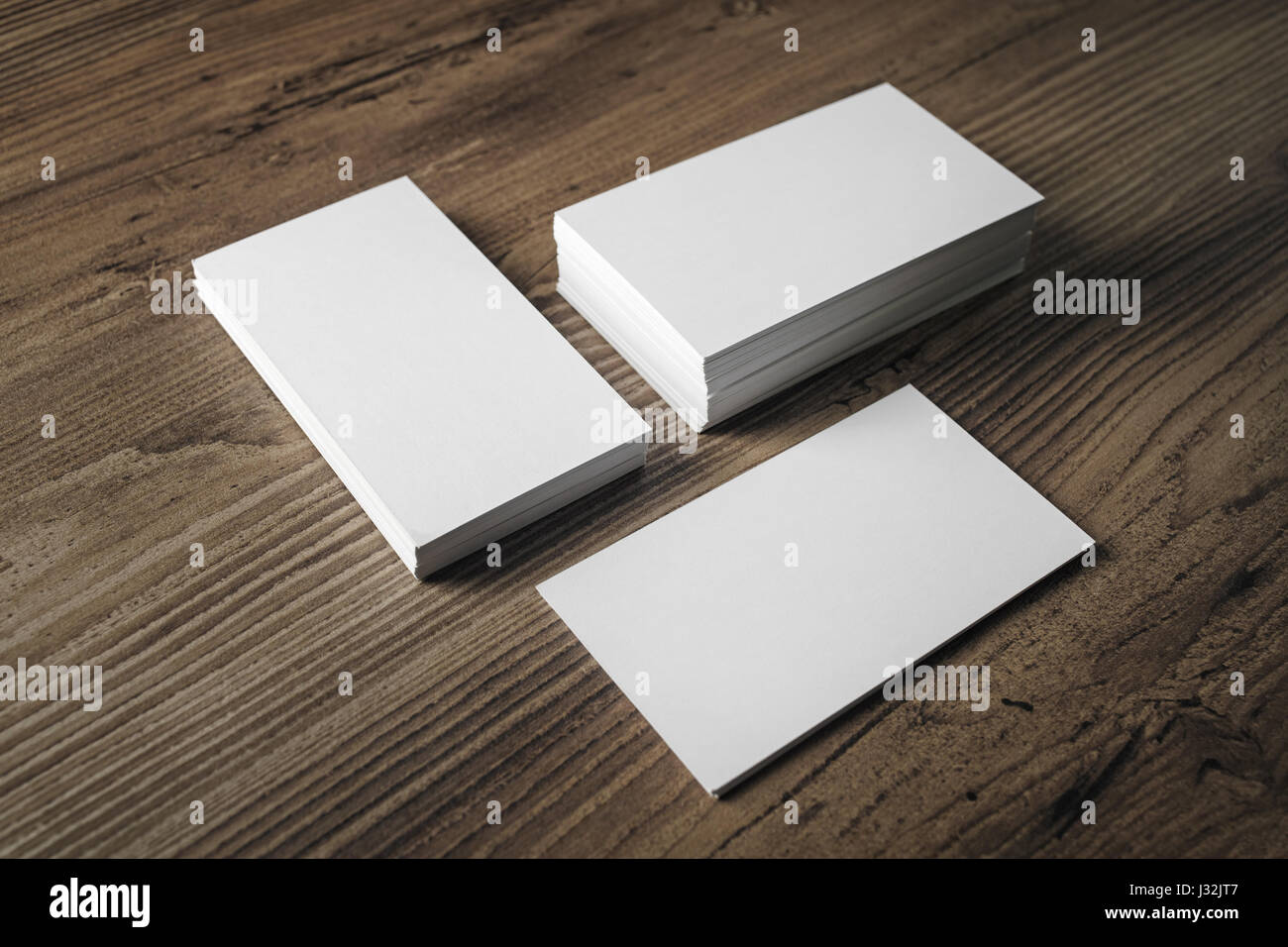 Stacks of blank name cards on wooden table background template for stacks of blank name cards on wooden table background template for branding identity business cards mock up reheart Gallery