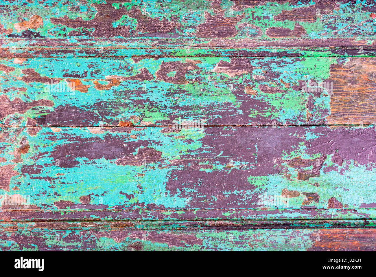 Abstract grunge wood planks texture background with peeling blue paint - Stock Image