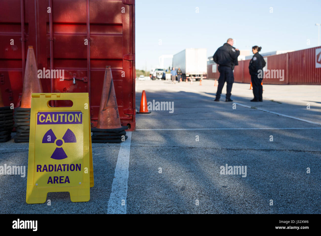 Officers with the U.S. Customs and Border Protection Office of Field Operations conduct inspections of commercial Stock Photo