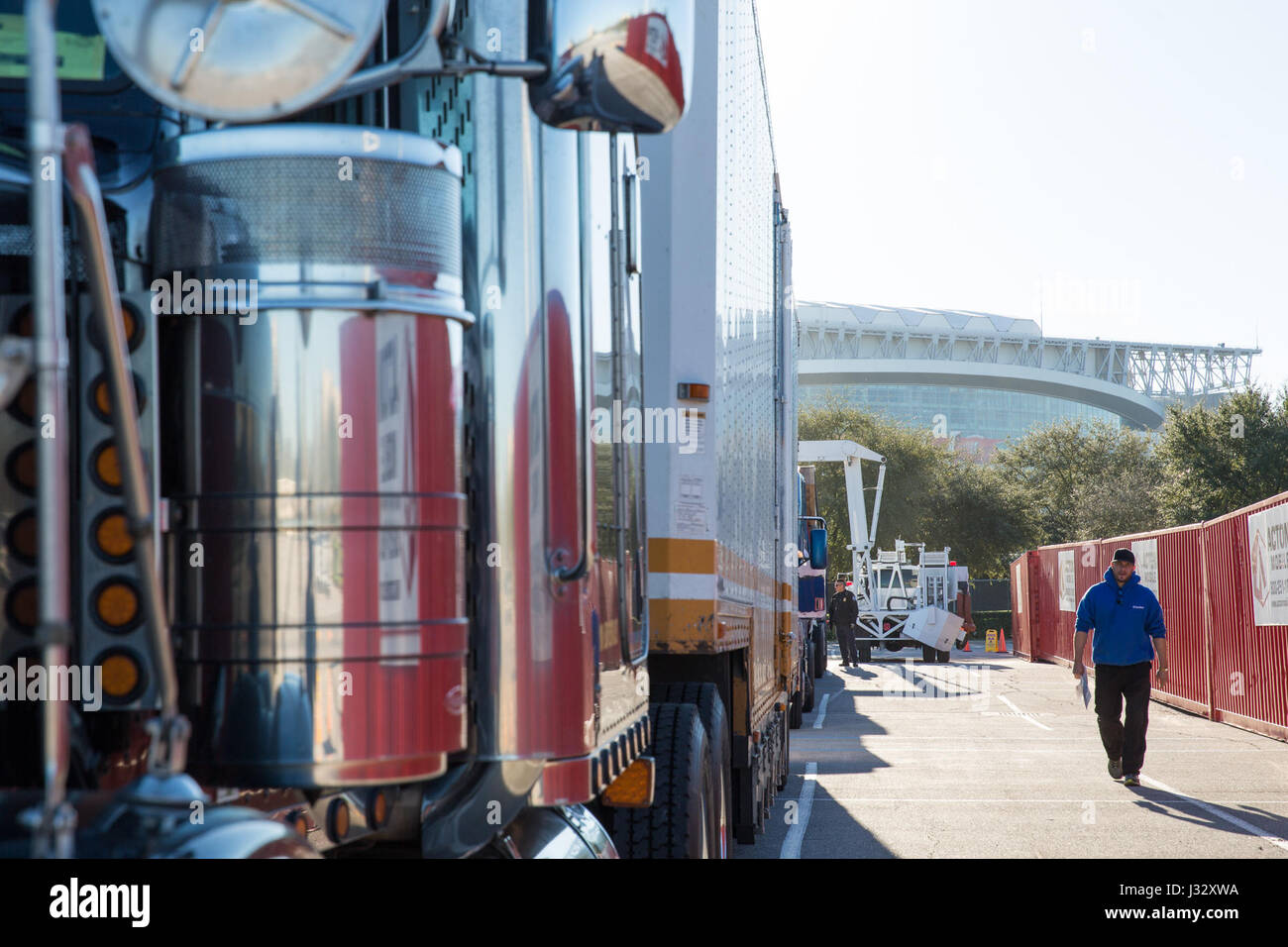 Trucks stand in a line as officers with the U.S. Customs and Border Protection Office of Field Operations conduct - Stock Image