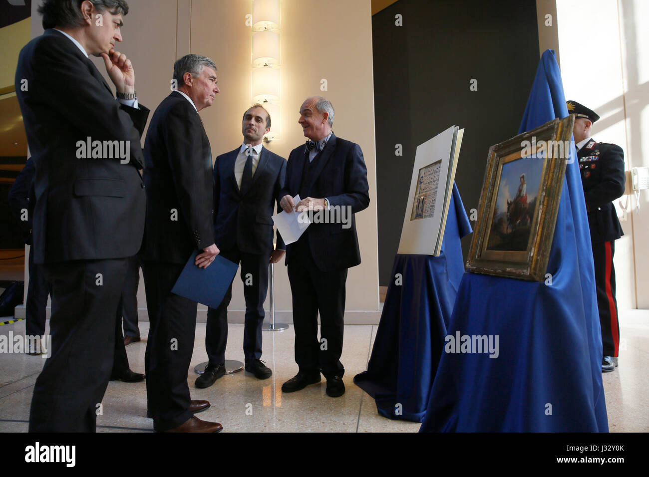 U.S. Customs and Border Protection Commissioner R. Gil Kerlikowske looks over two items on display as he attends - Stock Image