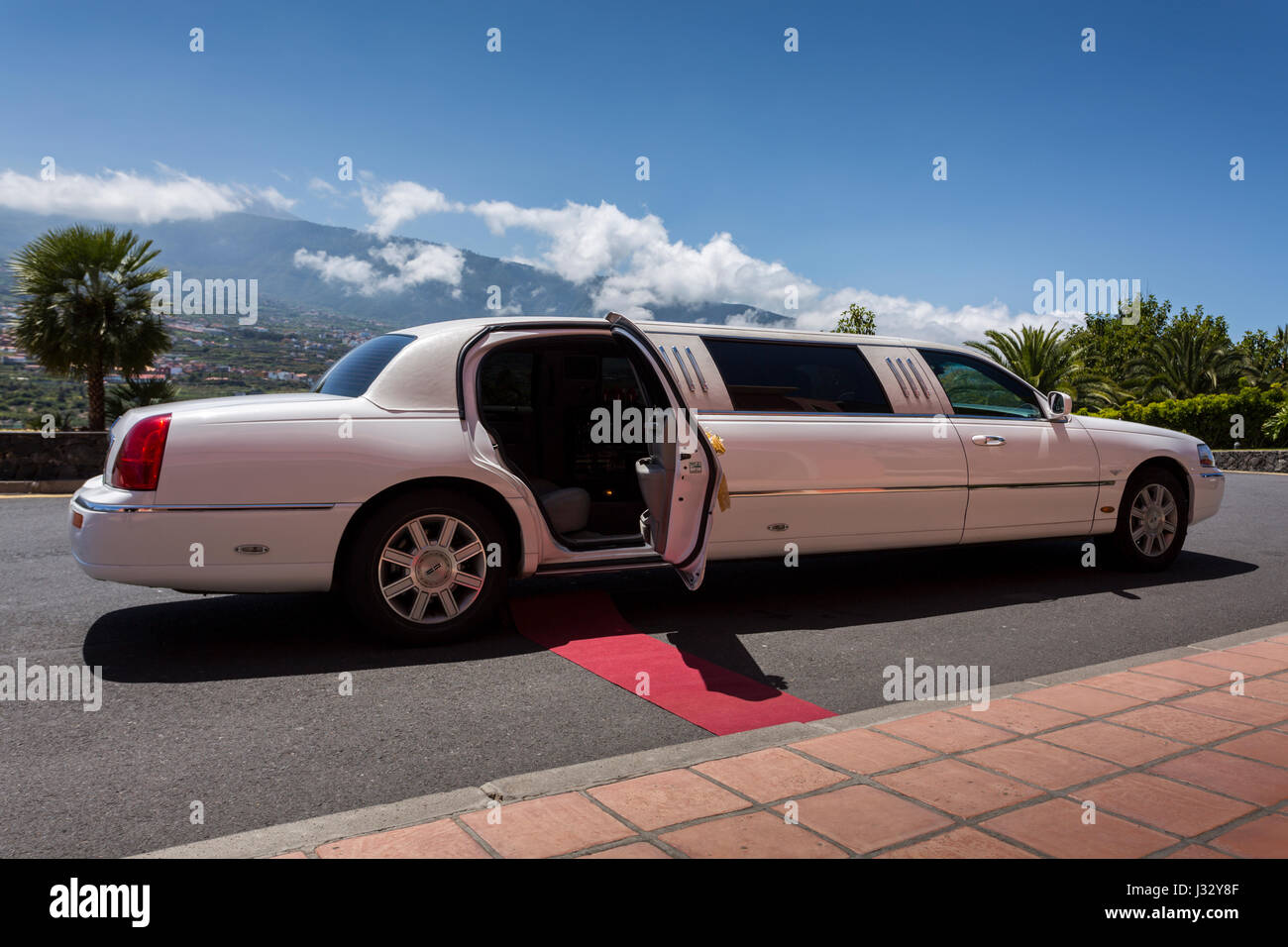 White Lincoln Limousine Car Decorated For A Wedding Party And With