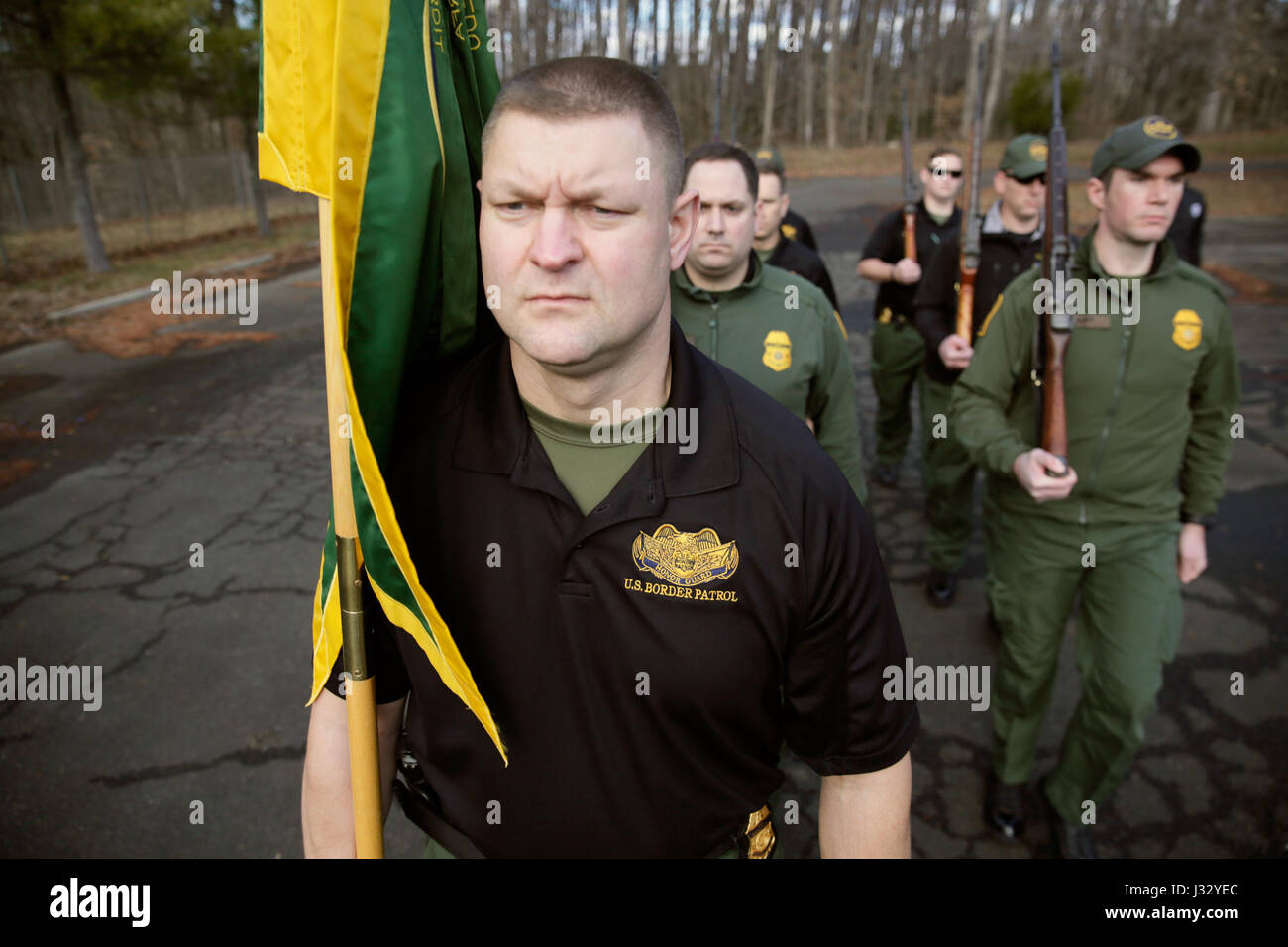 Members of the U S  Border Patrol Honor Guard rehearse at