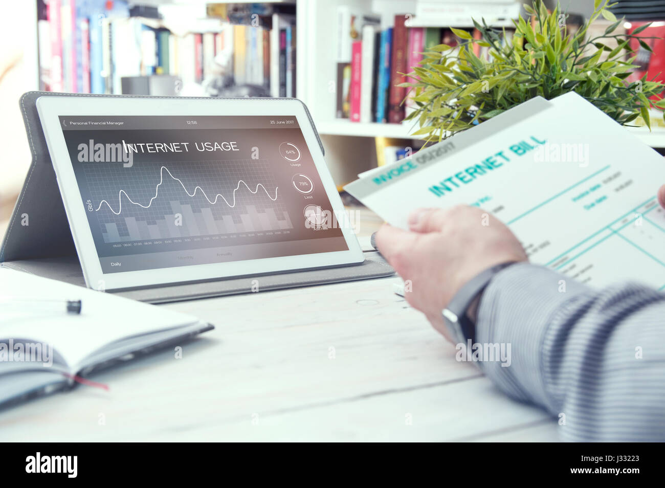 Tablet pc with internet usage application and man holds bill for internet. Internet usage application made in graphic - Stock Image