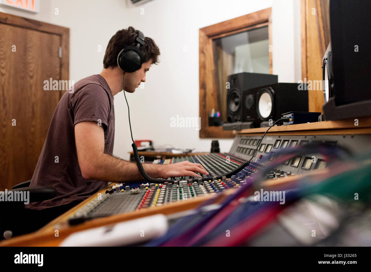 Audio engineer working at an instrument panel - Stock Image
