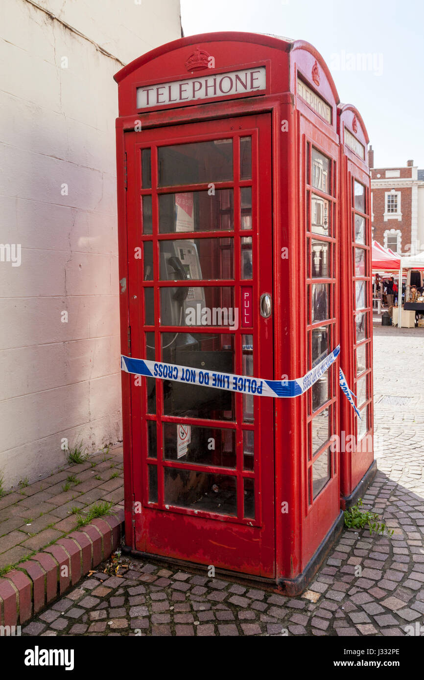 Crime scene: Police tape wrapped around a telephone box, Newark on Trent, Nottinghamshire, England, UK - Stock Image