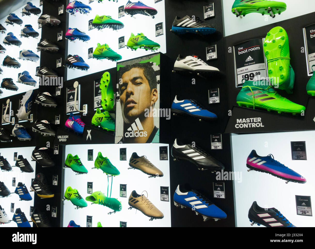 Adidas football boots dispay in Sports Direct store. UK - Stock Image