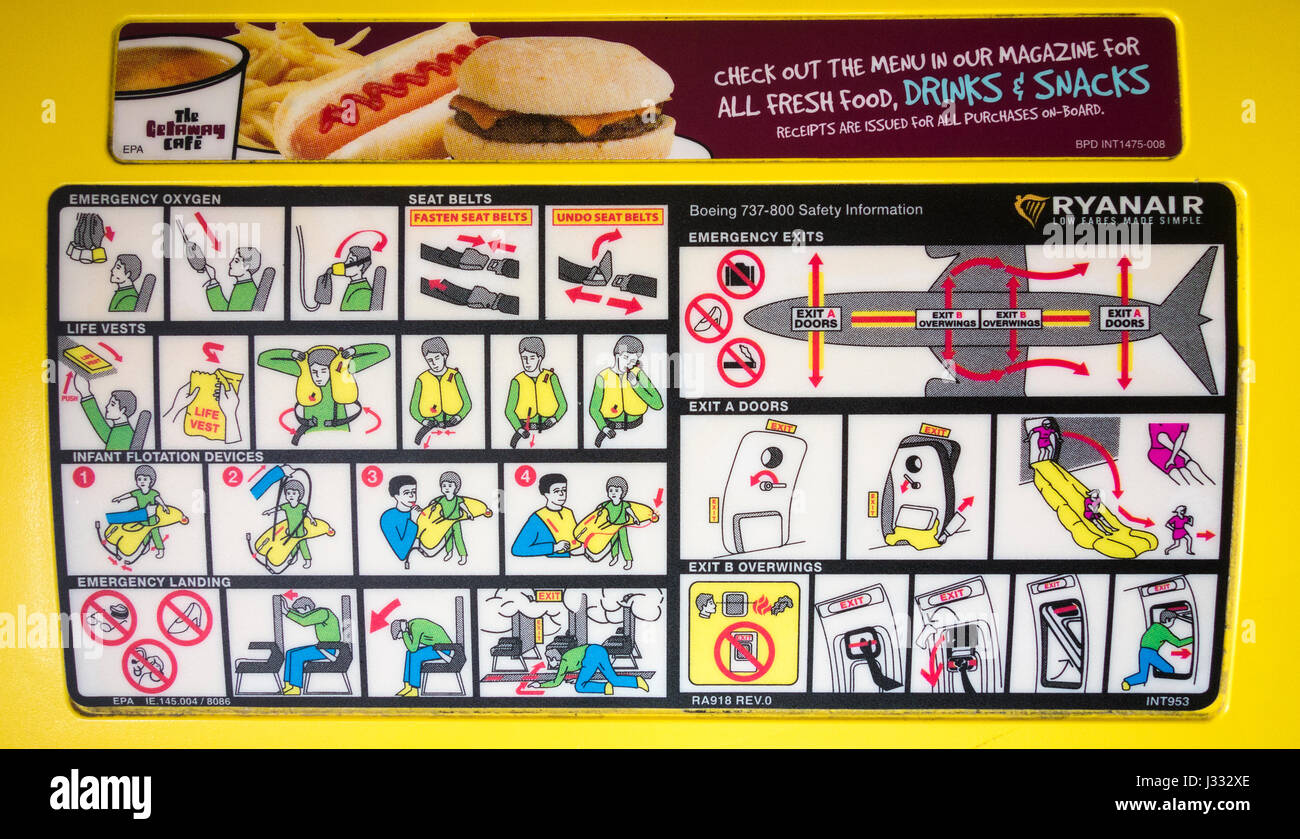 Ryanair safety instructions on back of seat headrest. - Stock Image