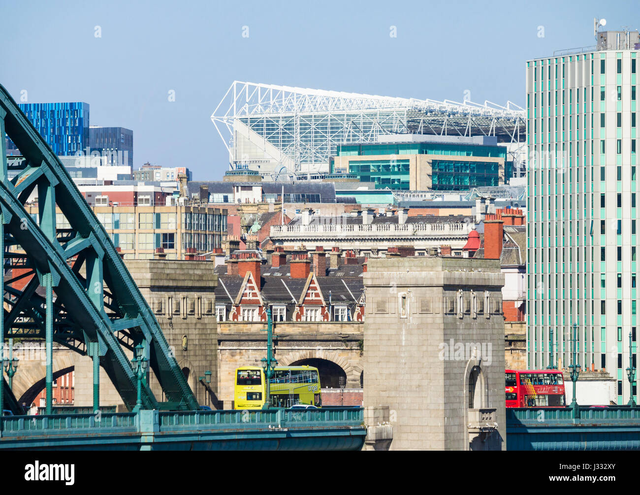 Newcastle: View over Tyne Bridge and city centre towards St James` park football stadium. Newcastle upon Tyne, England, Stock Photo