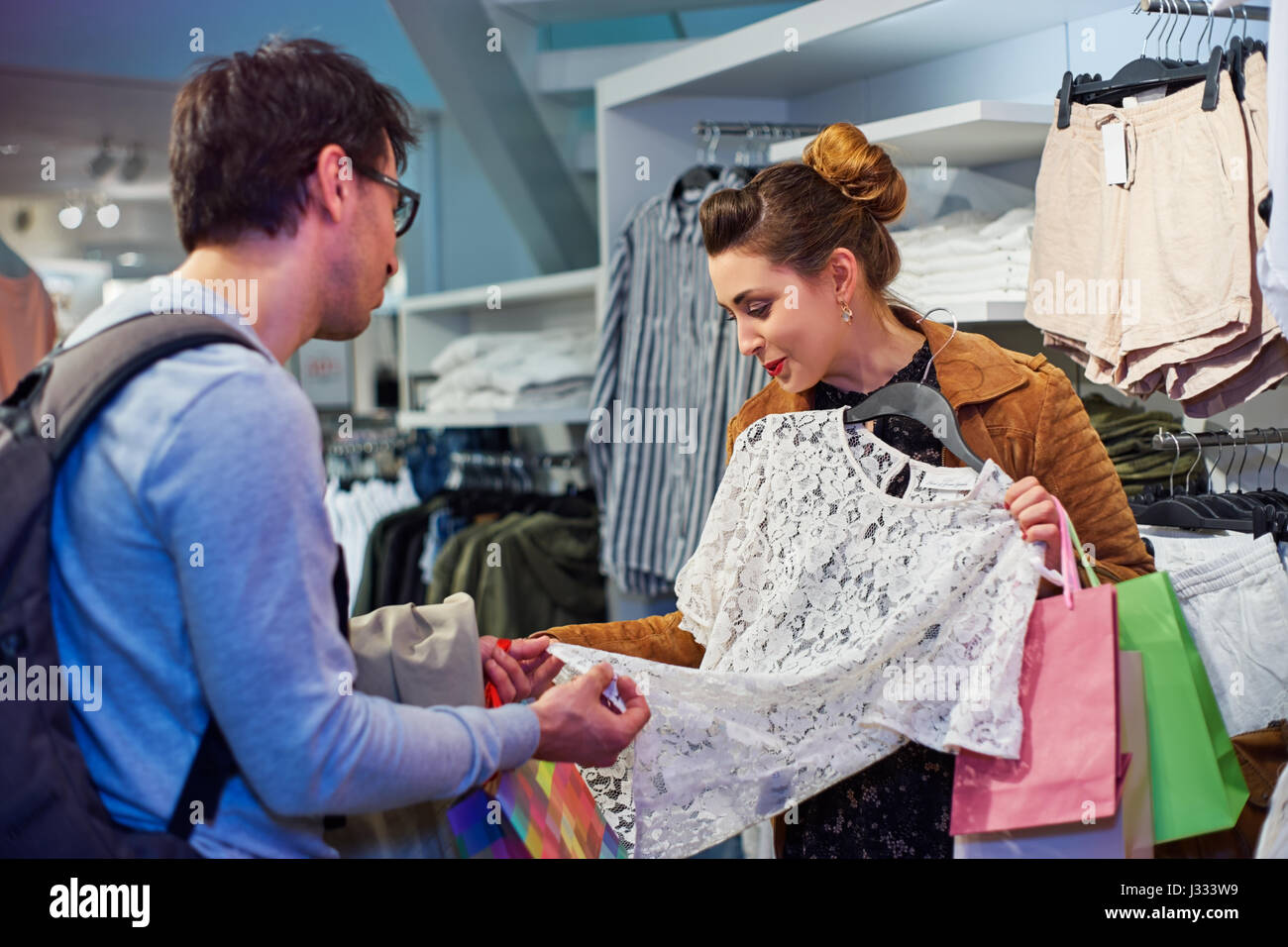 Woman and man in clothing store - Stock Image