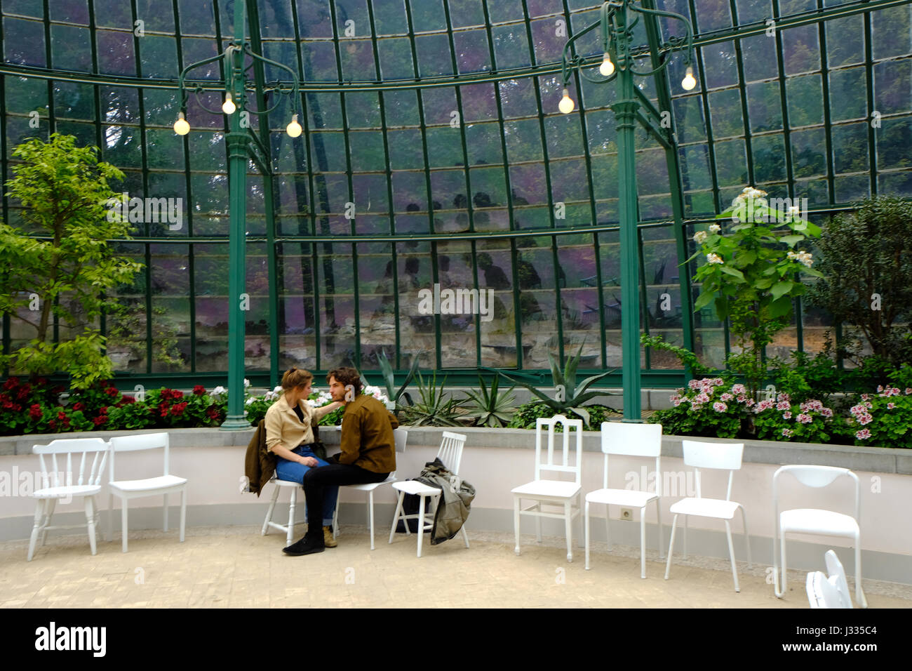 Couple in the restaurant of the Royal Greenhouses of Laeken - Stock Image