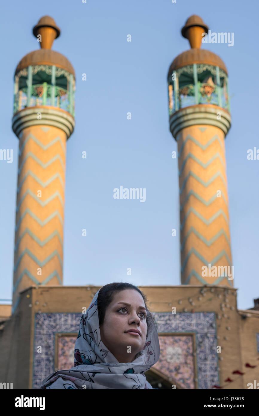 Beautiful Muslim Women In Front of Masque Menarets in Tehran, Iran Stock Photo