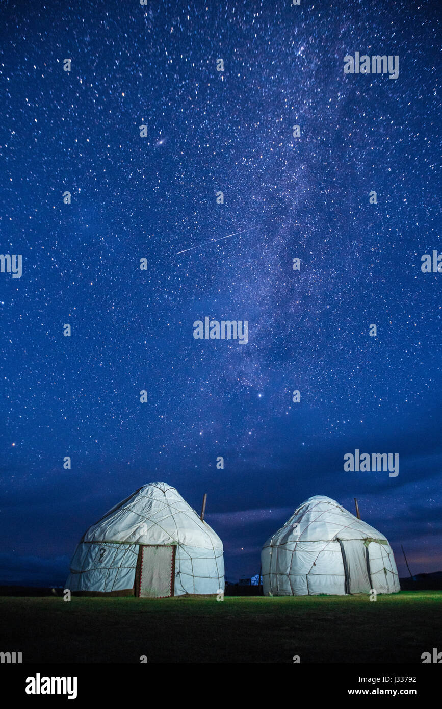 Two Kyrgyz yurts under the starry night near Lake Song kul in Kyrgyzstan - Stock Image