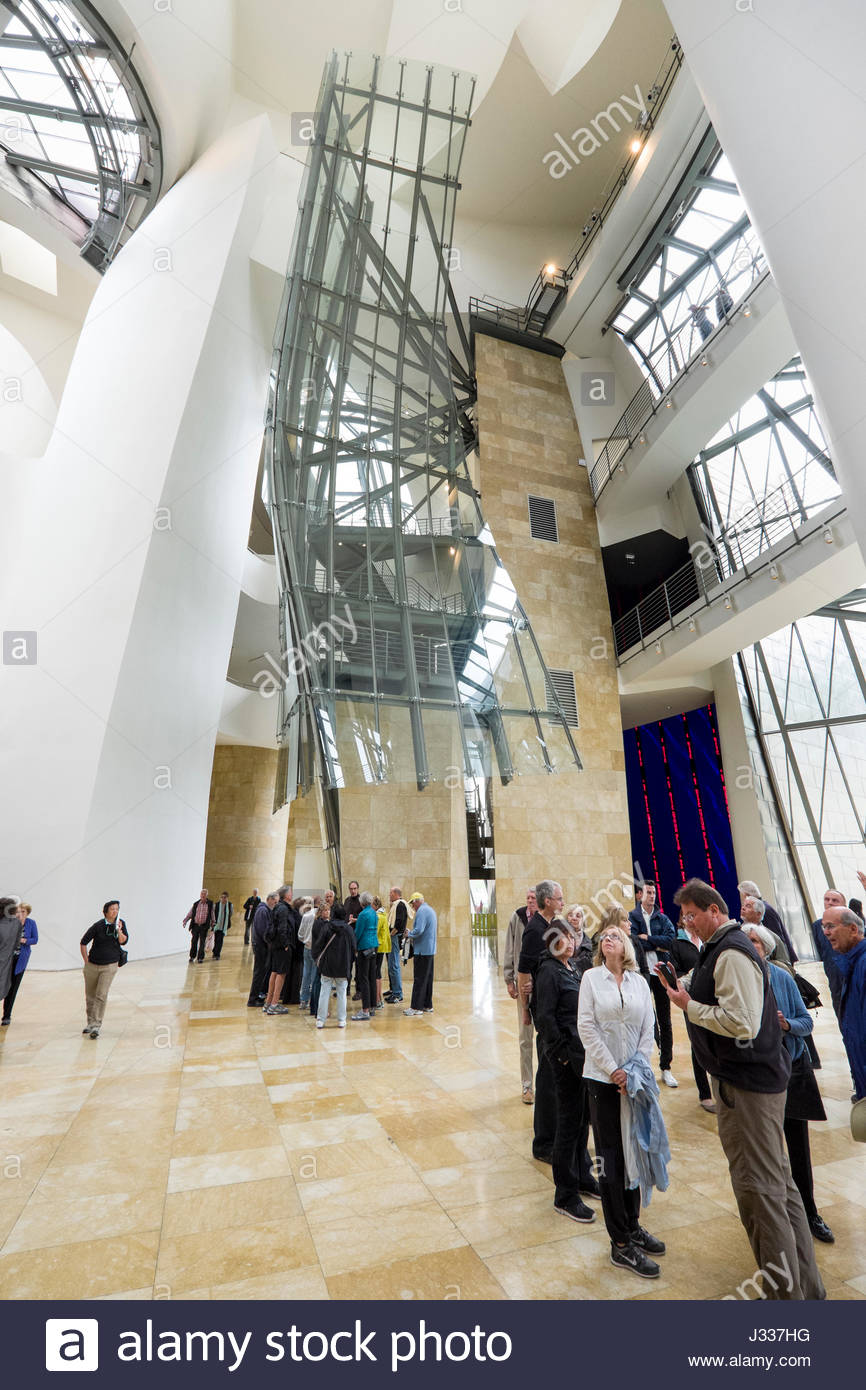 Groups of people inside the central atrium of the guggenheim museum stock photo 139598748 alamy for Guggenheim museum bilbao interior