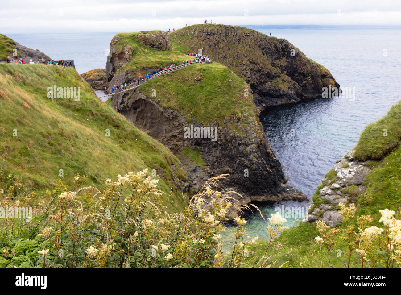 Carrick-a-Rede Rope Bridge is a  bridge near Ballintoy in County Antrim, Northern Ireland. The bridge links the - Stock Image