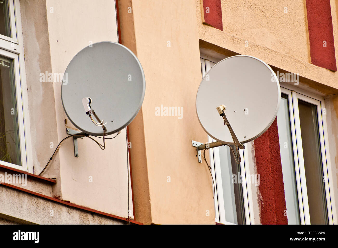 Satellite Dishes Hanging On A House External Wall Stock Photo Wiring