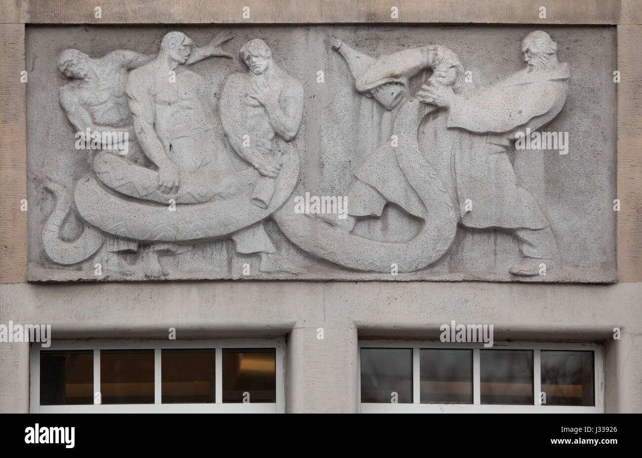 Fighting with the alcohol dependence syndrome. Relief by Hungarian sculptor Mihaly Biro on the south wing of the - Stock Image