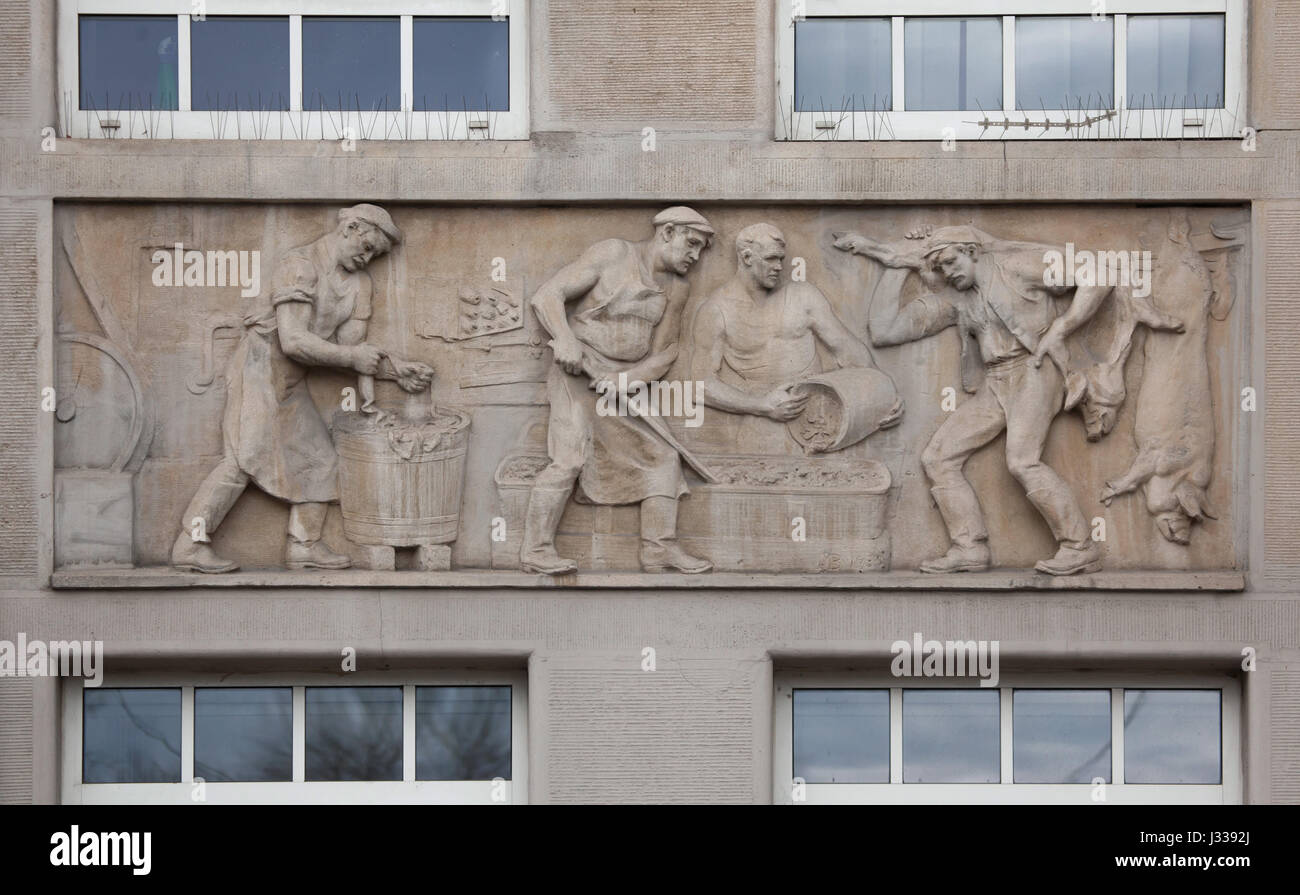 Accident in the slaughter-house. Relief by Hungarian sculptor Bela Markup (1930) on the north wing of the Art Deco - Stock Image