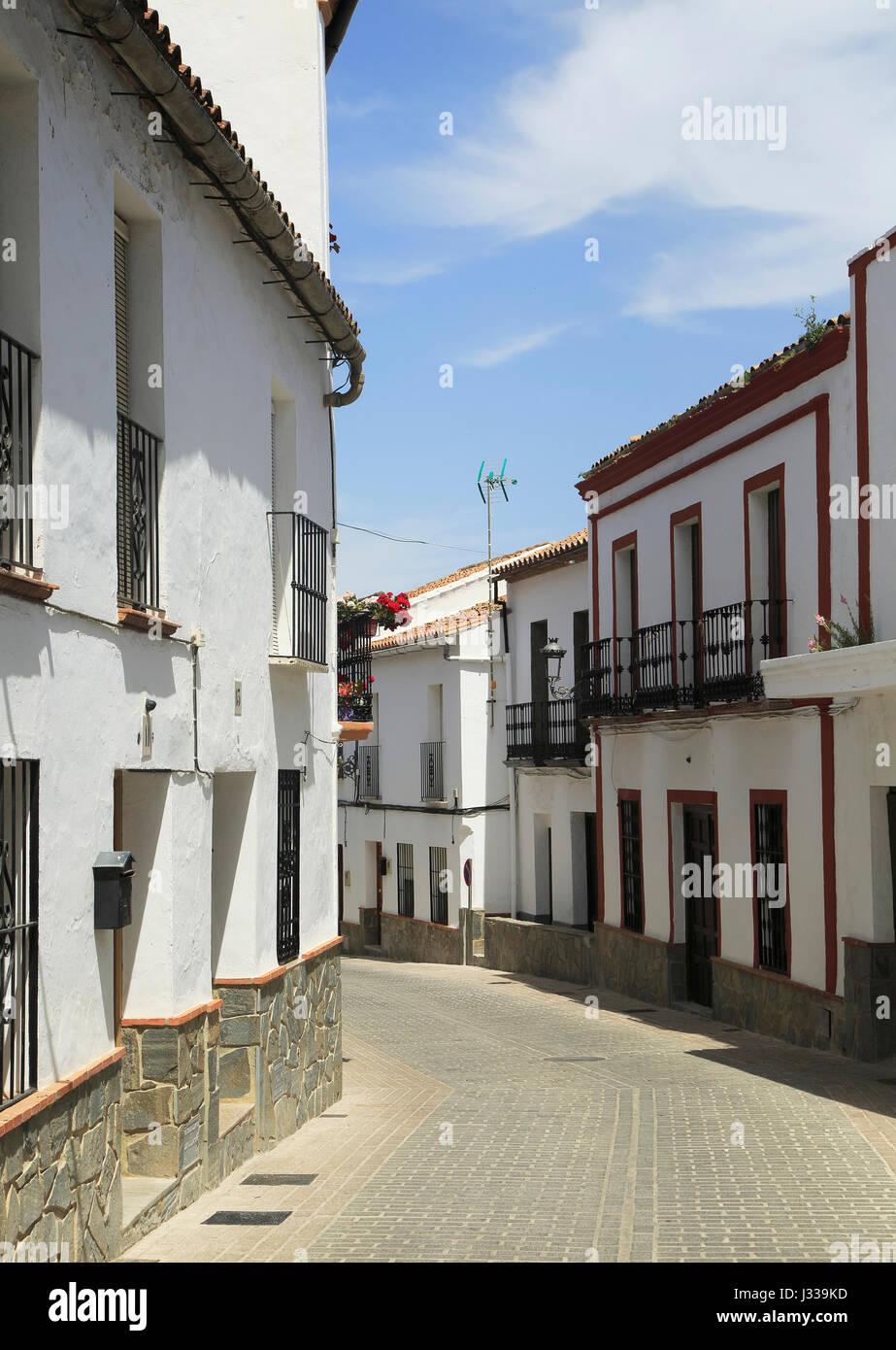 Whitewashed buildings narrow street, Montejaque, Serrania de Ronda, Malaga province, Spain - Stock Image