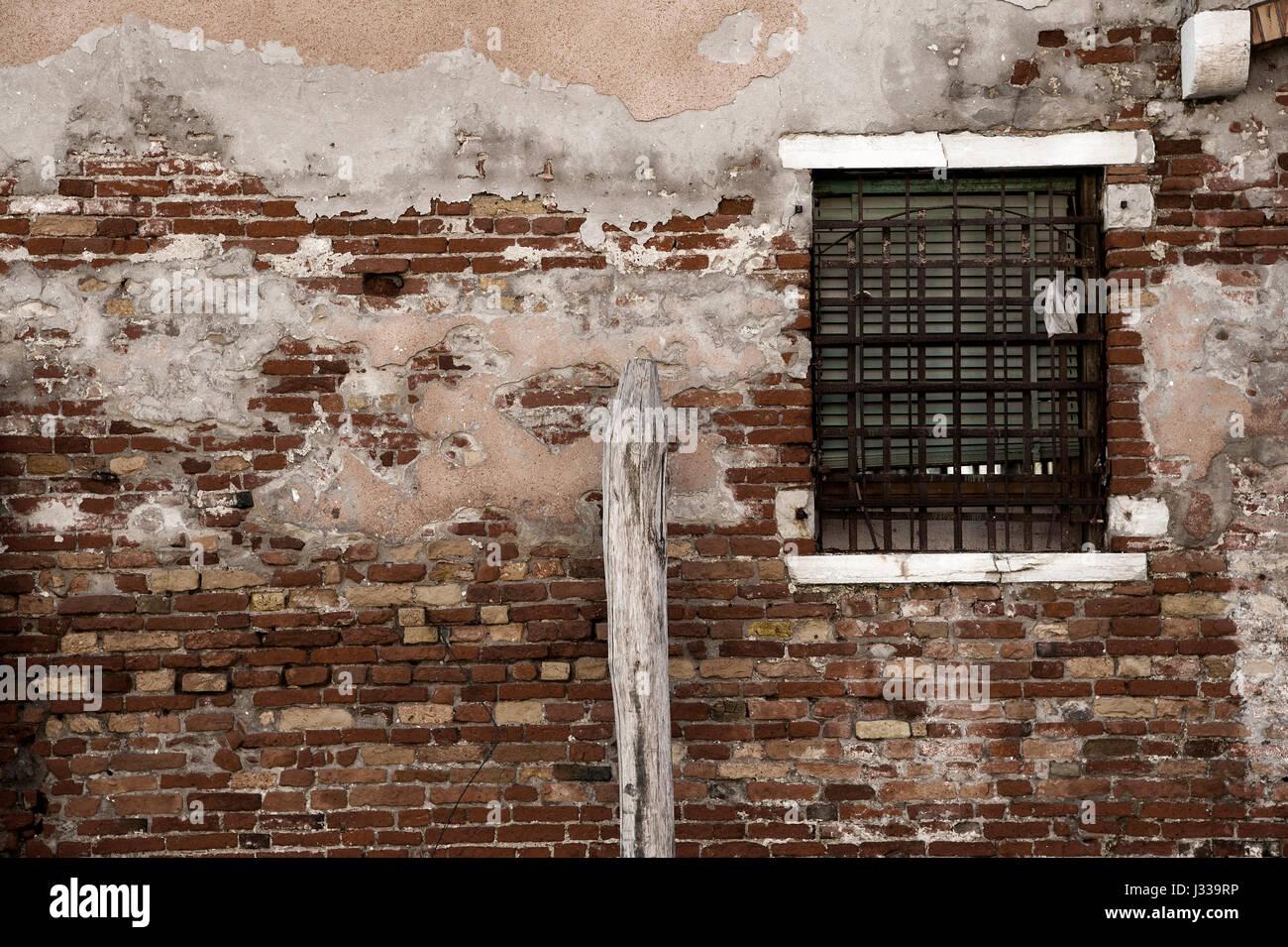 A window on a grunge wall of brick Stock Photo