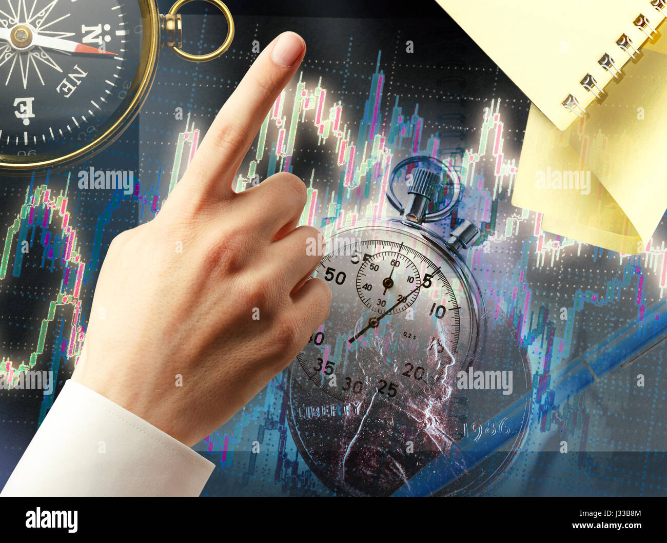Candlestick chart graphic and black compass in light Stock Photo