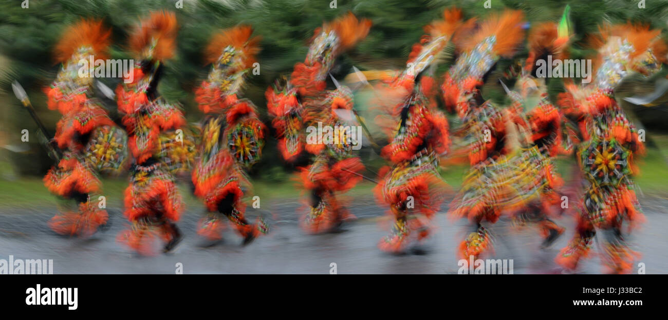 Dancers in motion wearing rtaditional costumes, Atiatihan Festival, Kalibo Aklan, Panay Island, Philippines, Asia - Stock Image