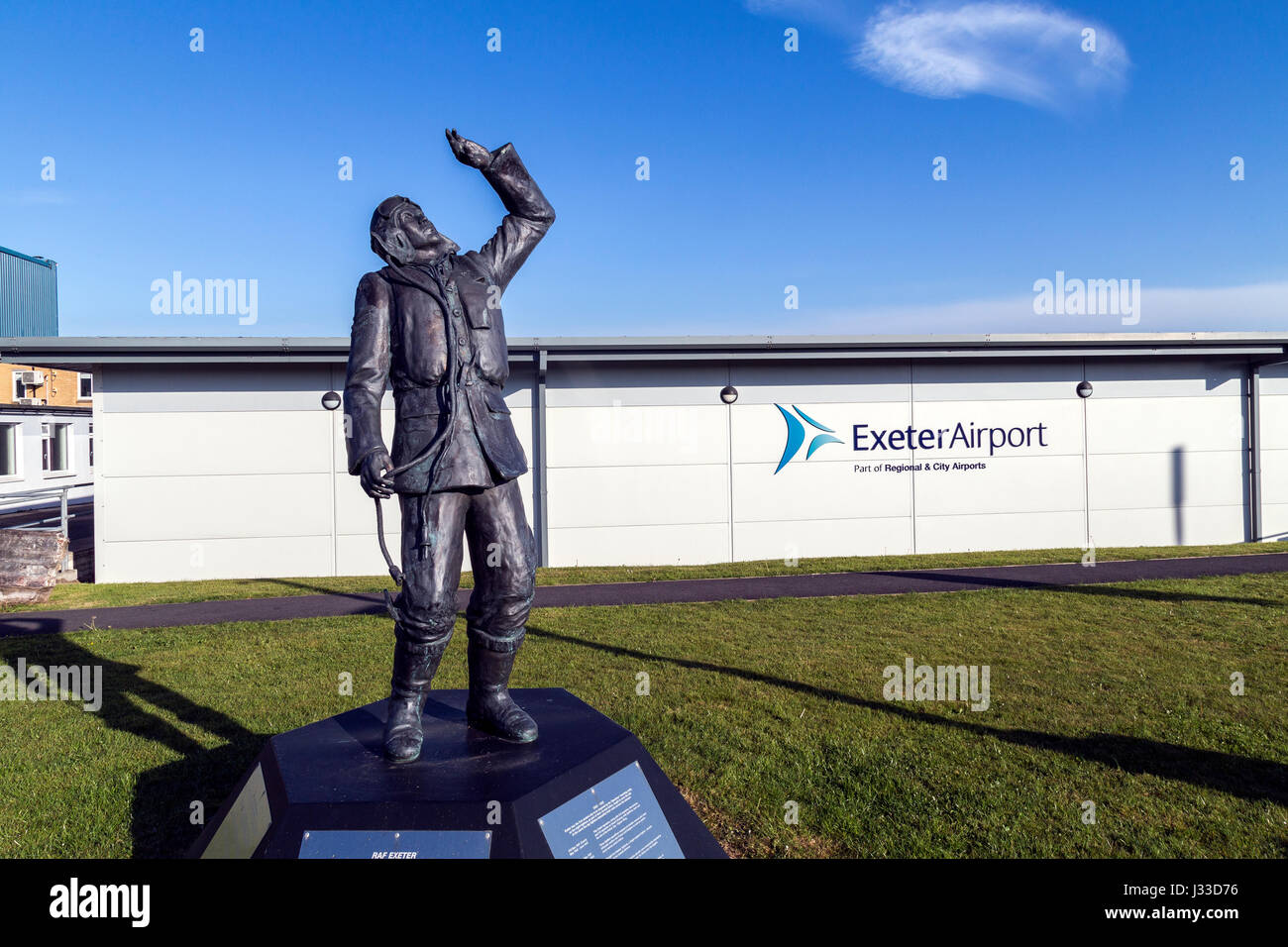 Battle of Britain hurricane fighter pilot statue outside Airport House office space and hanger 3 at Exeter airport,hurricane - Stock Image