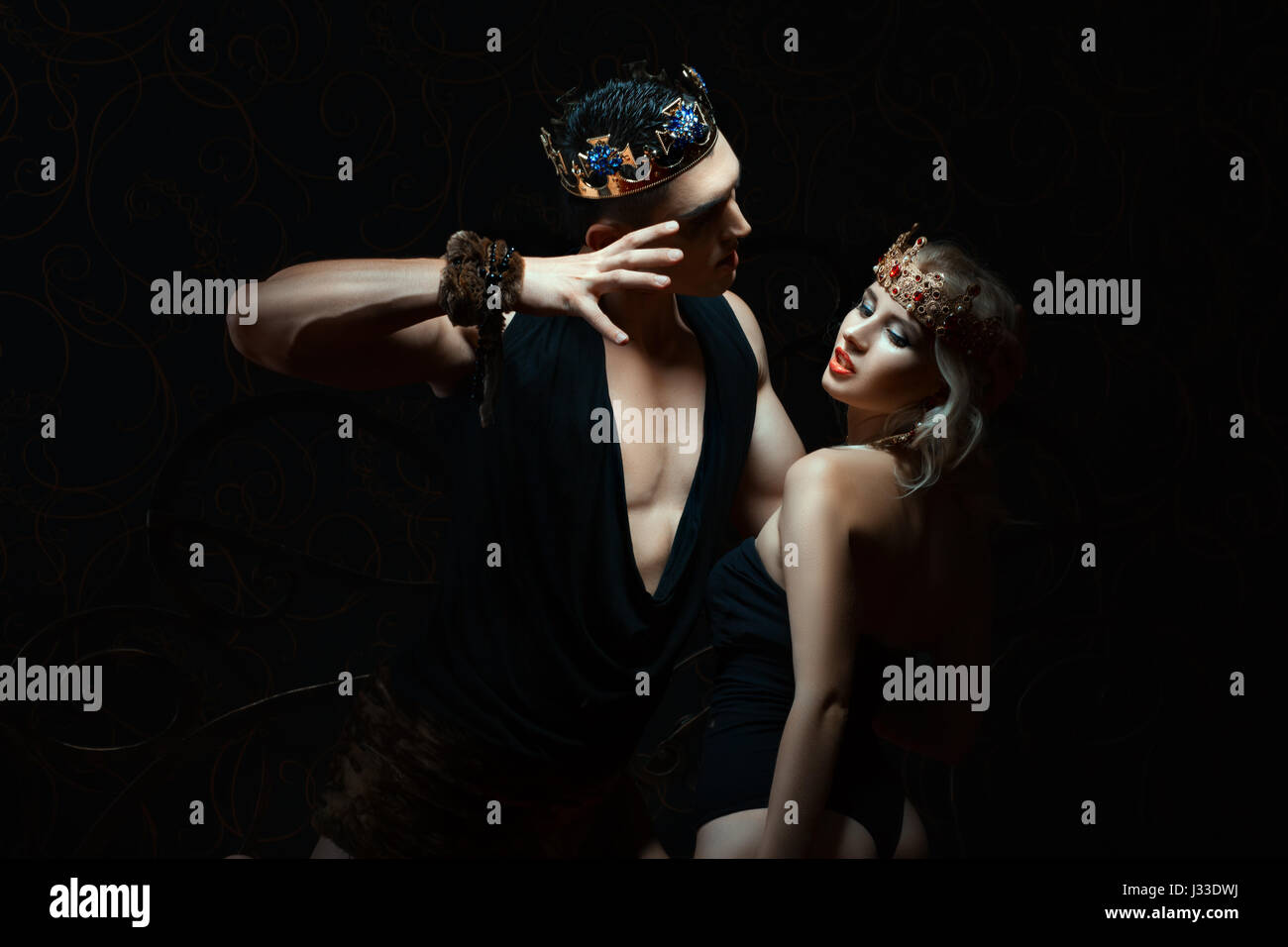 Man holds girl passionately. They play in the Kings. - Stock Image