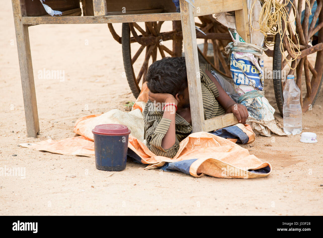 Illustrative image. Pondicherry, Tamil Nadu, India - July 03, 2014. Poor man worker in small village, very hard - Stock Image