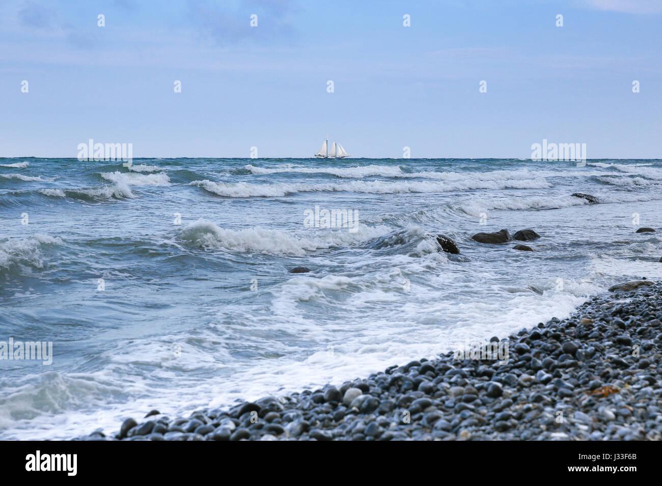 View over Baltic Sea to sailing ship on the horizon, Mons Klint, Klintholm, Mon island, Denmark Stock Photo