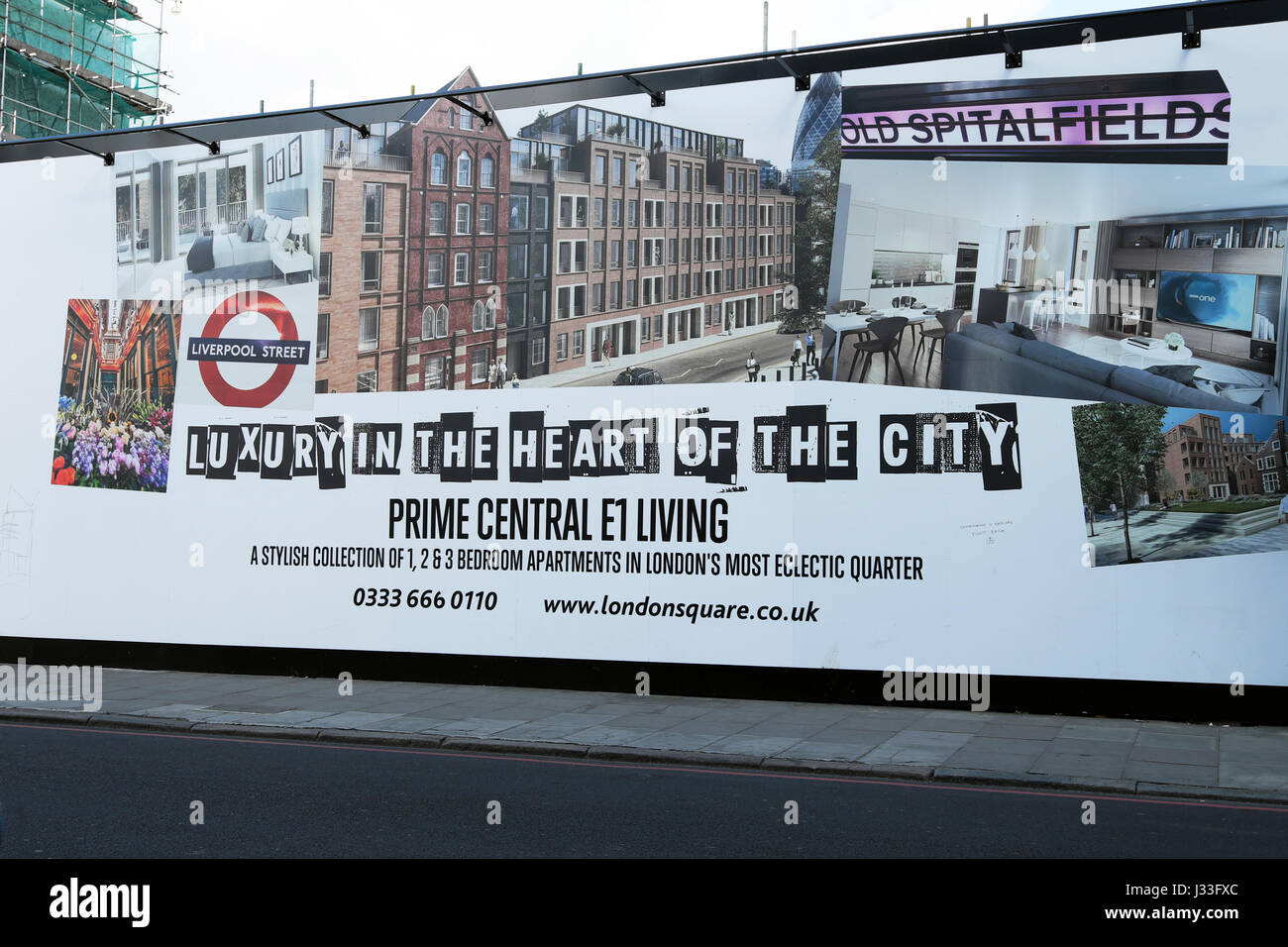 Property advert hoarding advertising luxury living apartments near the Spitalfields Tower Hamlets area of the East - Stock Image