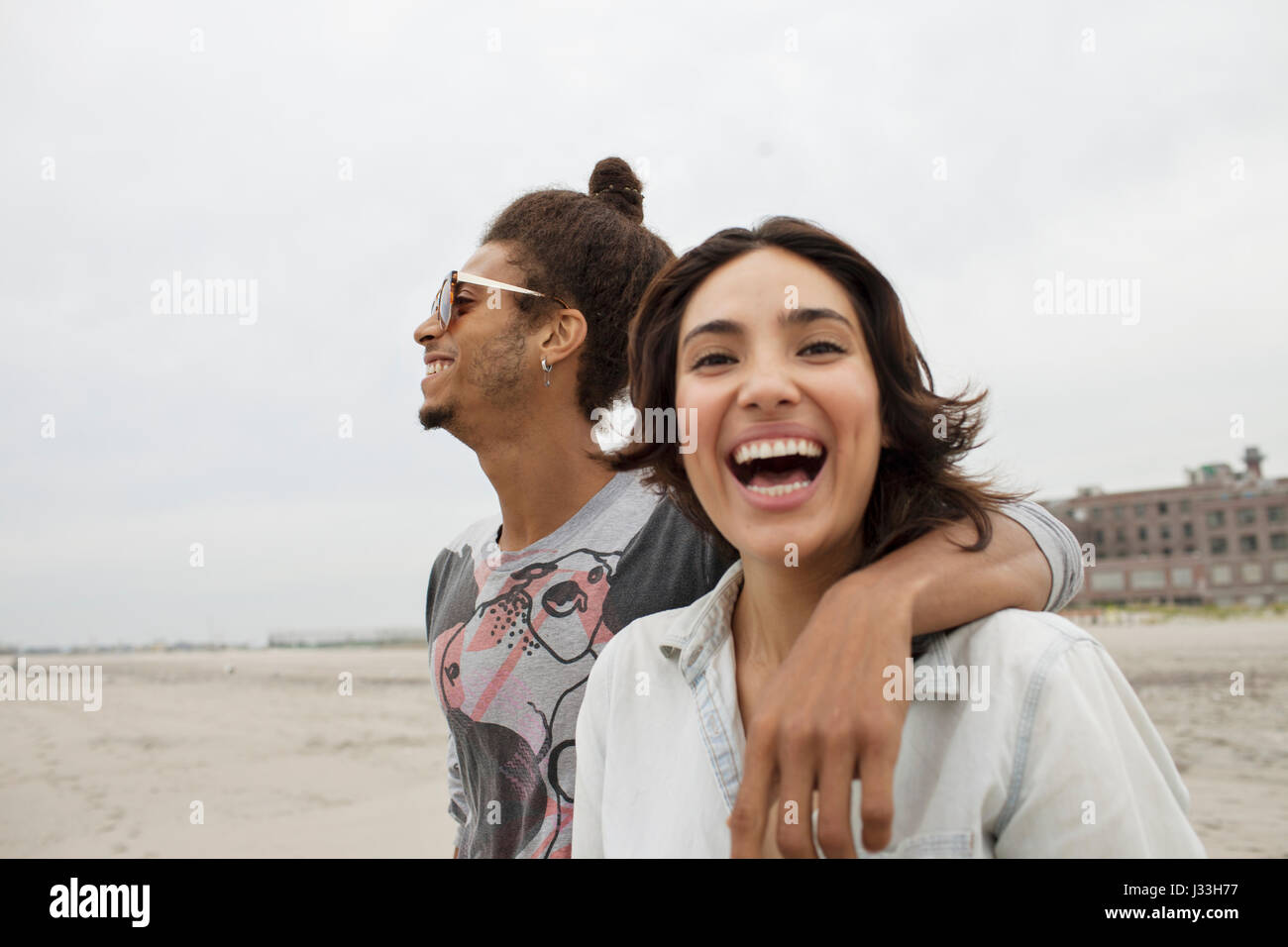 Young couple hanging out at the beach - Stock Image