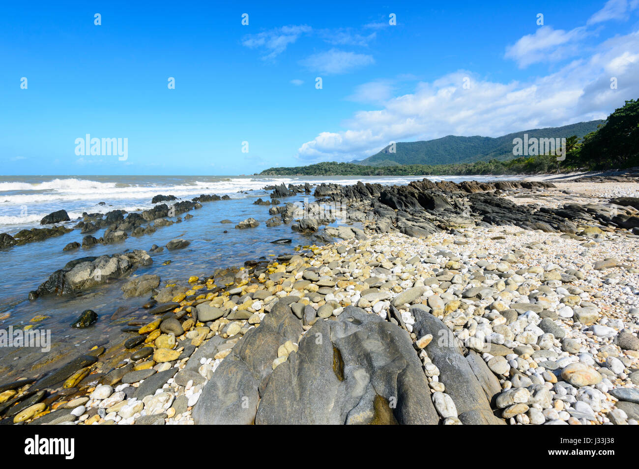 Scenic rugged rocky coast between Cairns and Port Douglas, Far North Queensland, FNQ, QLD, Australia Stock Photo