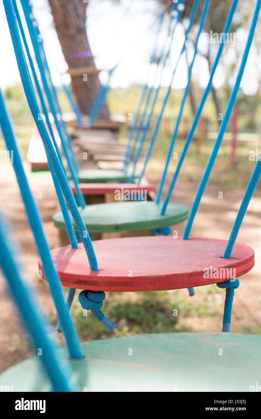 Adventure playground baby balance test path, selective focus obstacle in foreground - Stock Image