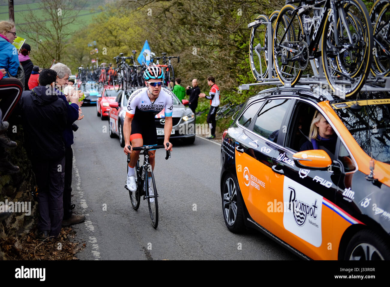 Matt Crenshaw of Madison Genesis rides up the Côte de Silsden on stage three of the third Tour de Yorkshire. - Stock Image