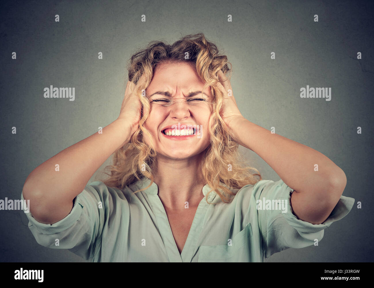 Stressed woman upset frustrated - Stock Image