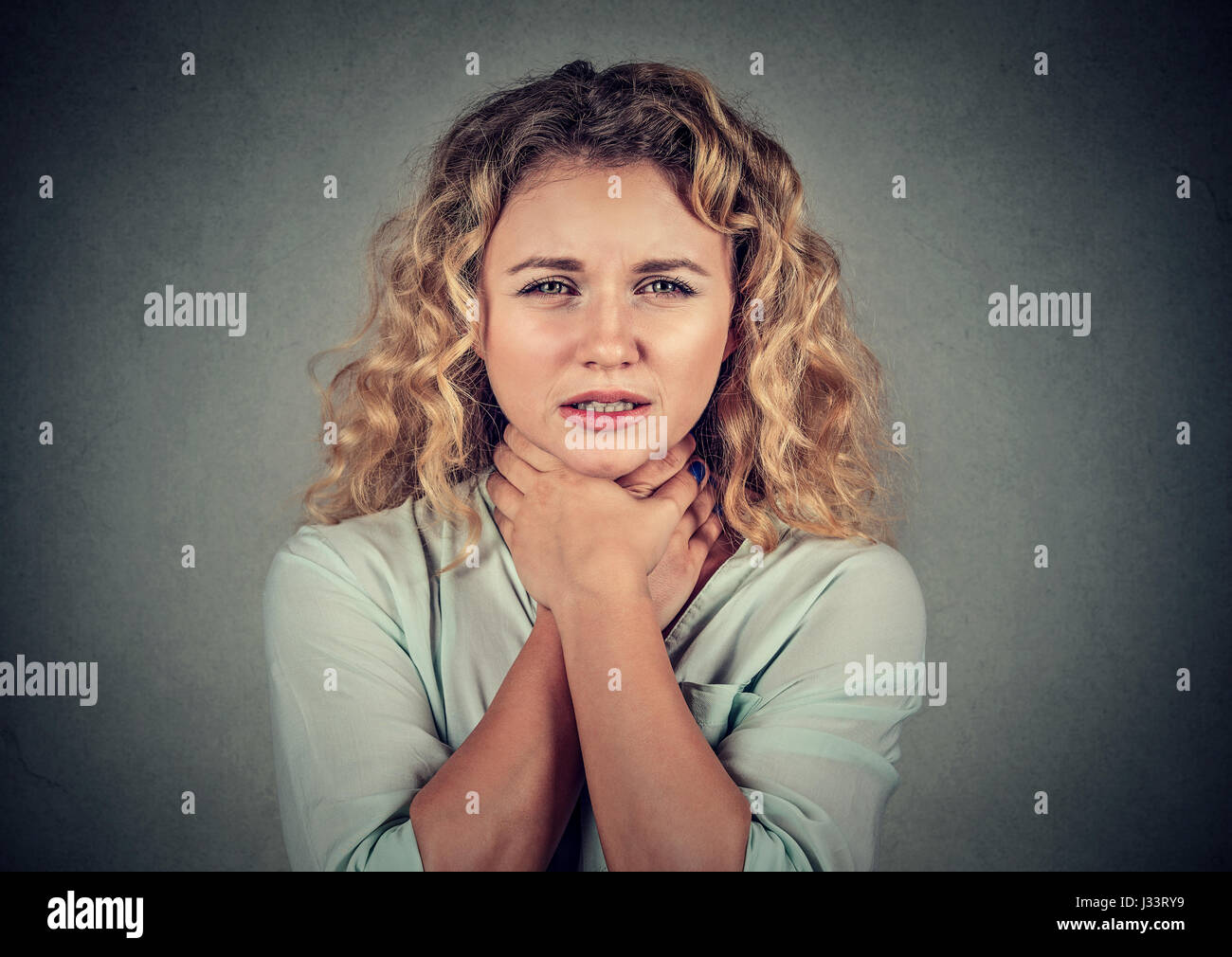 Young woman having asthma attack or choking can't breath - Stock Image