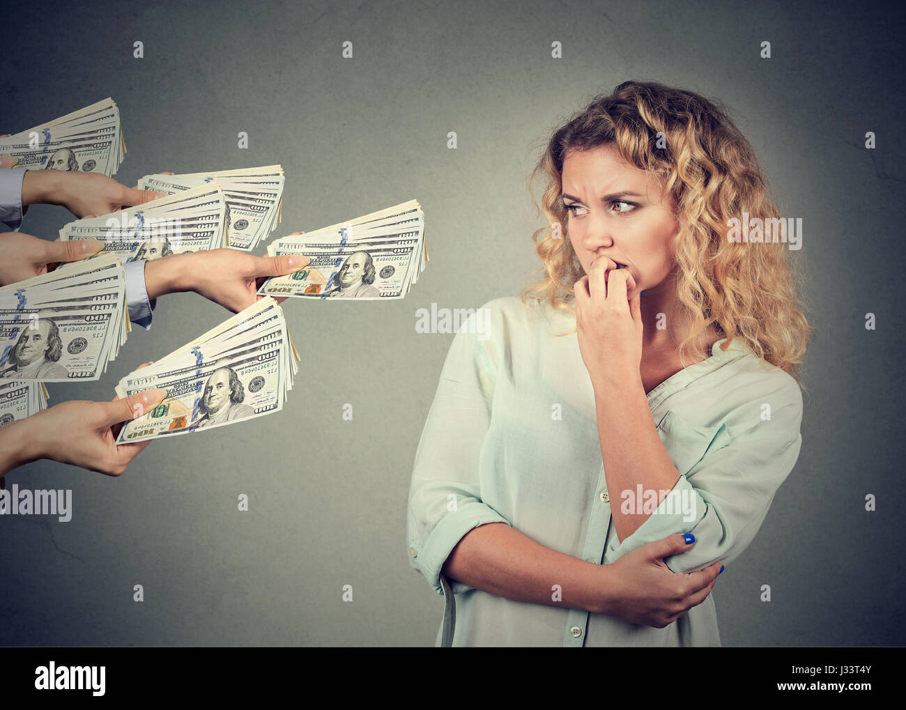 Woman hesitant to take bribe from people - Stock Image
