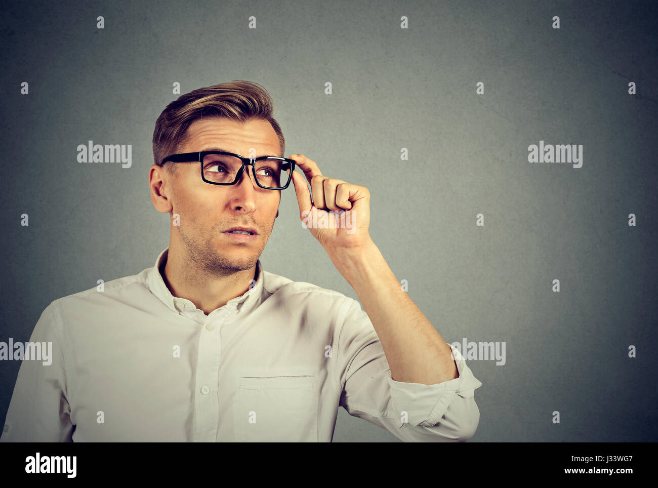 Side profile of a man in glasses - Stock Image