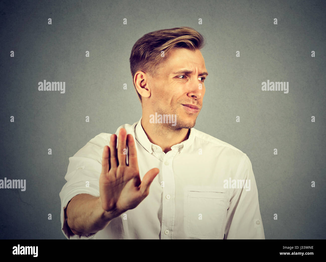 Portrait disgusted young man. Negative human emotion - Stock Image