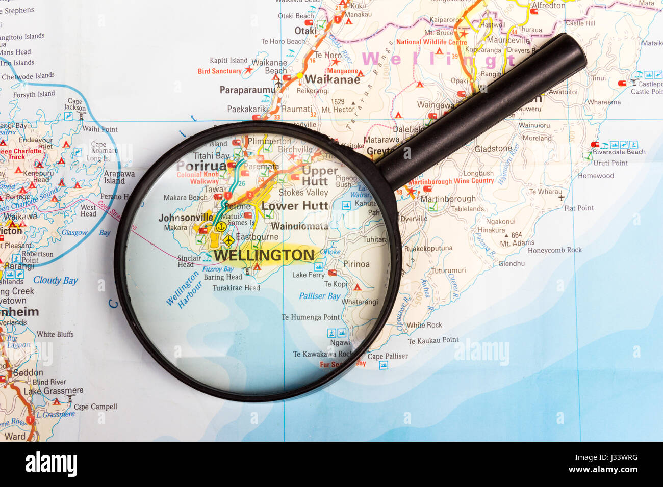 Map of New Zealand with magnifying glass focussing on Wellington, North Island - Stock Image