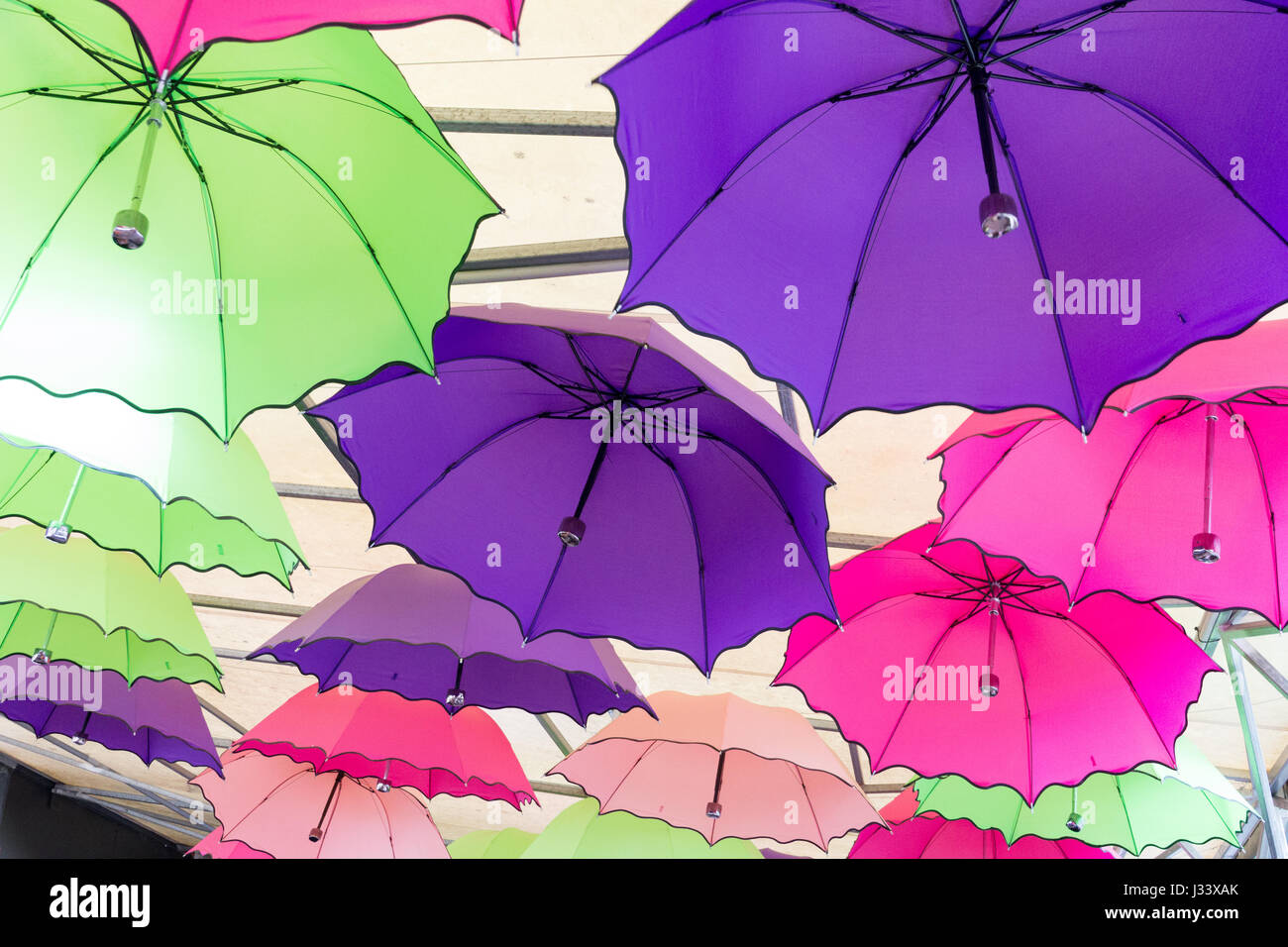 Colourful umbrellas used for decoration - Stock Image