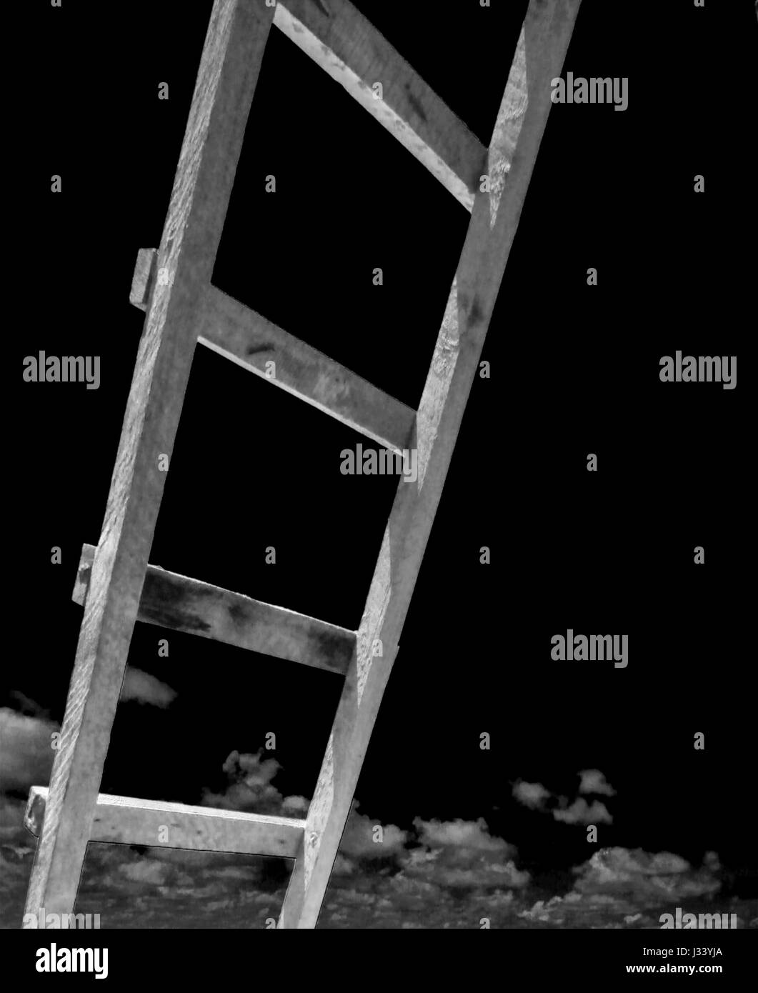 Black and white ladder reaching to the sky - Stock Image