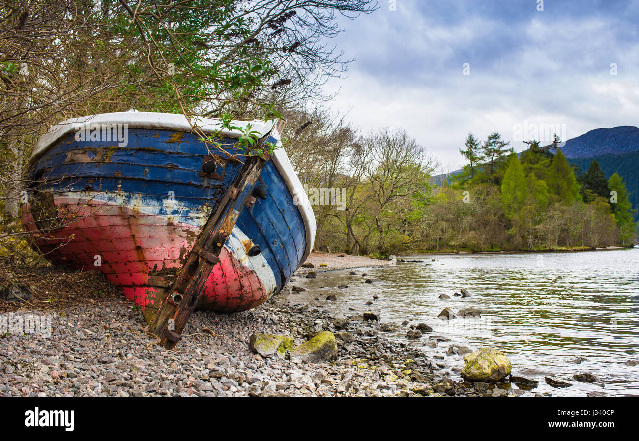 Old boat on the shore of Loch Ness - Stock Image